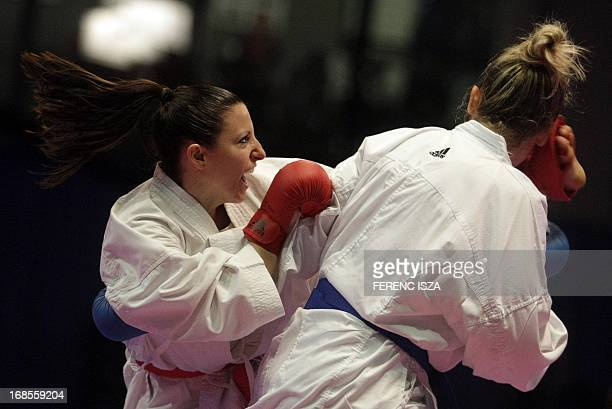 Croatia's Anamarija Celan fights to win the gold medal against France's Alexandra Recchia in their team's final fight at the 48th Karate Senior...