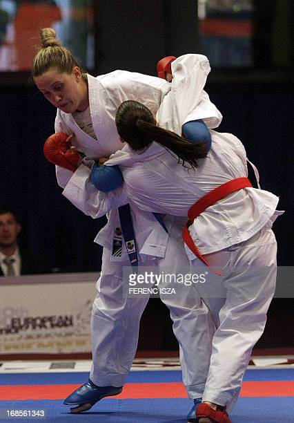 Croatia's Anamarija Celan fights to win the gold medal against France's Alexandra Recchia in team final of the 48th Karate Senior European...