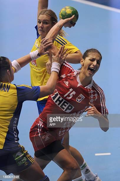 Croatia's Andrea Penezic tries to shoot through Sweden's defense during their Women's World Handball Championship match in Sao Bernardo do Campo, in...