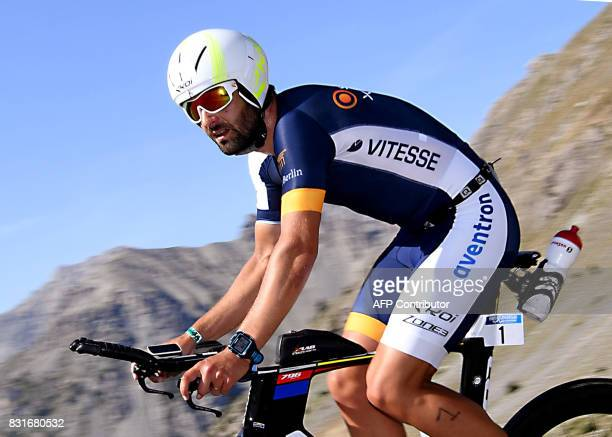 Croatia's Andrej Vistica rides through the Col d'Izoard mountain pass during the cycling portion of the 34th edition of the Ironman triathlon on...