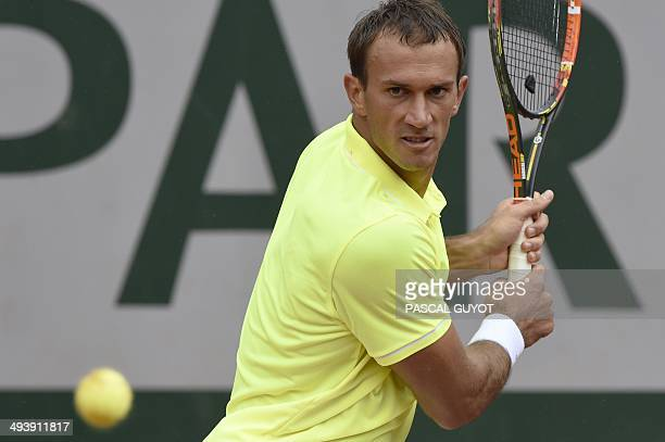 Croatia's Ante Pavic returns the ball to France's Gilles Simon during their French tennis Open first round match at the Roland Garros stadium in...