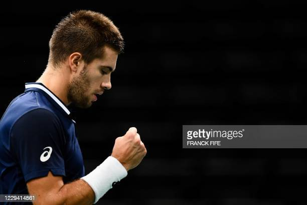 Croatia's Borna Coric celebrates after winning a point against Hungary's Marton Fucsovics during their men's singles first round tennis match on day...