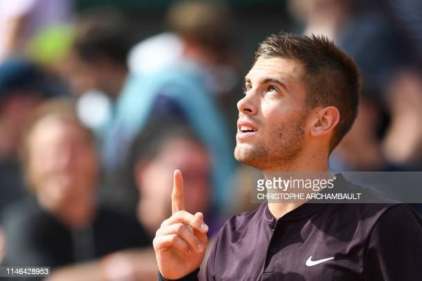 Croatia's Borna Coric celebrates after winning against Britain's Aljaz Bedene in their men's singles first round match on day two of The Roland...
