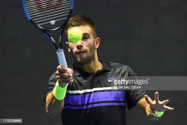 Croatia's Borna Coric hits a return to Russia's Daniil Medvedev during their St Petersburg Open tennis tournament final match in Saint Petersburg on...