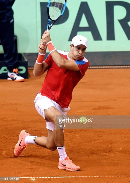 Croatia's Borna Coric returns the ball to Canada's Denis Shapovalov during the first round Davis Cup tennis match between Croatia and Canada at...