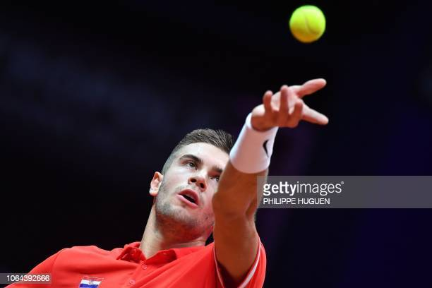 Croatia's Borna Coric serves to France's Jeremy Chardy during the opening single tennis match as part of the Davis Cup final between France and...