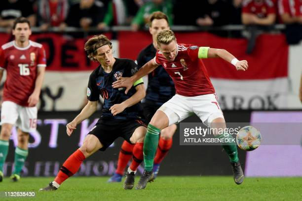 Croatia's captain midfielder Luka Modric vies for the ball with Hungary's captain midfielder Balazs Dzsudzsak during the UEFA Euro 2020 football 1st...