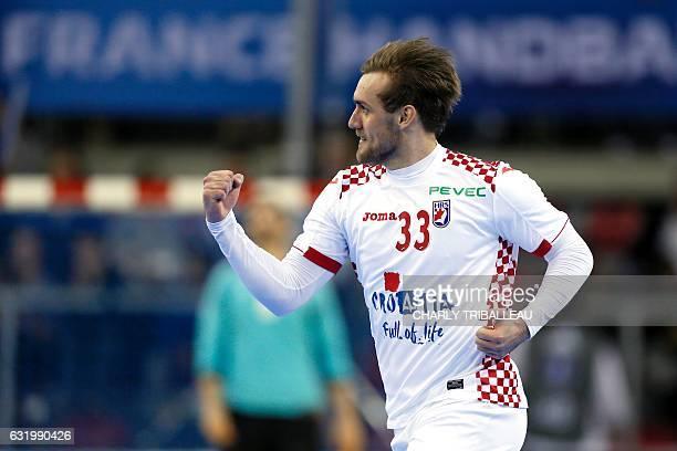 Croatia's centre back Luka Cindric celebrates a goal during the 25th IHF Men's World Championship 2017 Group C handball match Croatia vs Chile on...