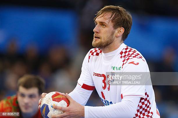 Croatia's centre back Luka Cindric holds the ball during the 25th IHF Men's World Championship 2017 Group C handball match Croatia vs Belarus on...