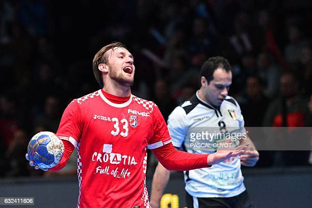 Croatia's centre back Luka Cindric reacts during the 25th IHF Men's World Championship 2017 eighth final handball match Croatia vs Egypt on January...