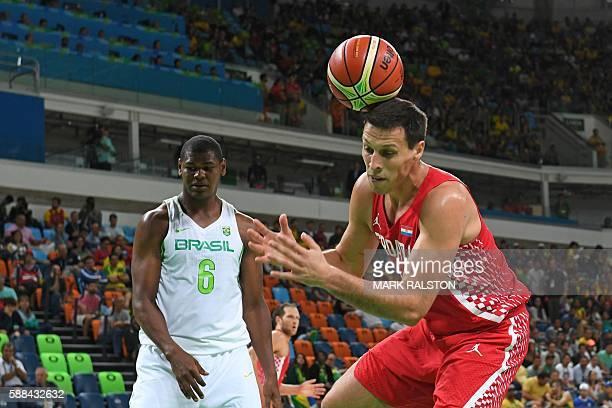 TOPSHOT Croatia's centre Darko Planinic 9R fails to catch a rebound next to Brazil's centre Cristiano Felicio during a Men's round Group B basketball...