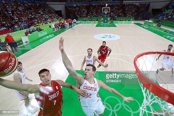 Croatia's centre Darko Planinic defends against Serbia's shooting guard Bogdan Bogdanovic during a Men's quarter final basketball match between...