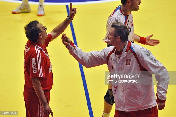 Croatia's coach Lino Cervar gestures close to Poland's coach Bogdan Wenta on January 30 during the EHF EURO 2010 Handball Championship semifinal...