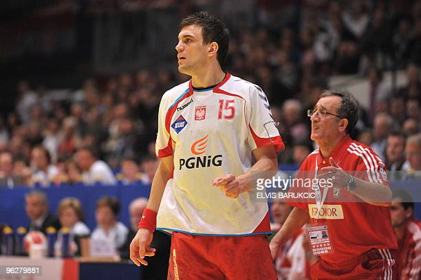 Croatia's coach Lino Cervar reacts close to Poland's Michael Jurecki on January 30 during the EHF EURO 2010 Handball Championship semifinal Croatia...