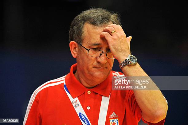 Croatia's coach Lino Cervar scratches his forehead as he concentrates on January 30 during the EHF EURO 2010 Handball Championship semifinal Croatia...