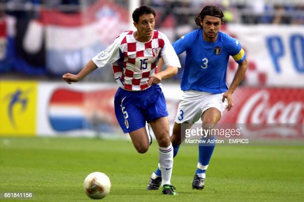 Croatia's Daniel Saric moves away from Italy's Paolo Maldini