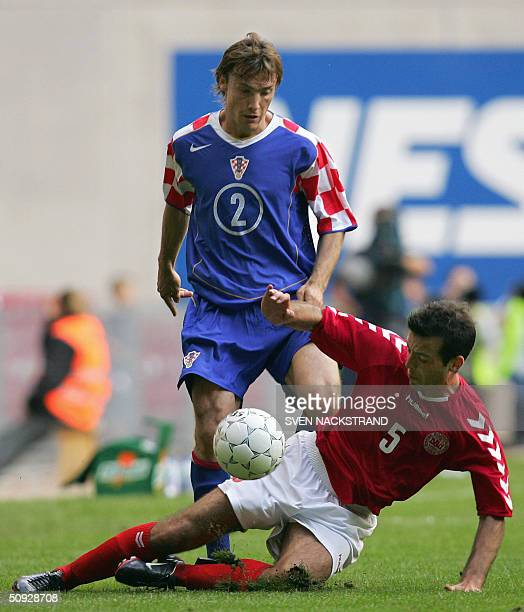 Croatia's Dario Simic is blocked by Denmark's Niclas Jensen in a preEURO 2004 friendly match in Copenhagen 05 June 2004 Croatia won 21