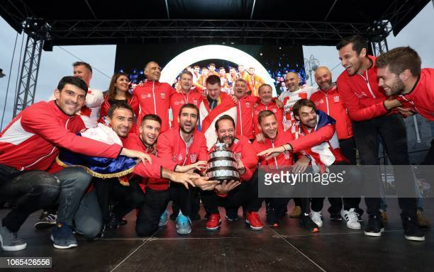 Croatia's Davis Cup team celebrates onstage with the Davis Cup Trophy during the welcome ceremony at Zagreb's Main Square on November 26 2018 Several...