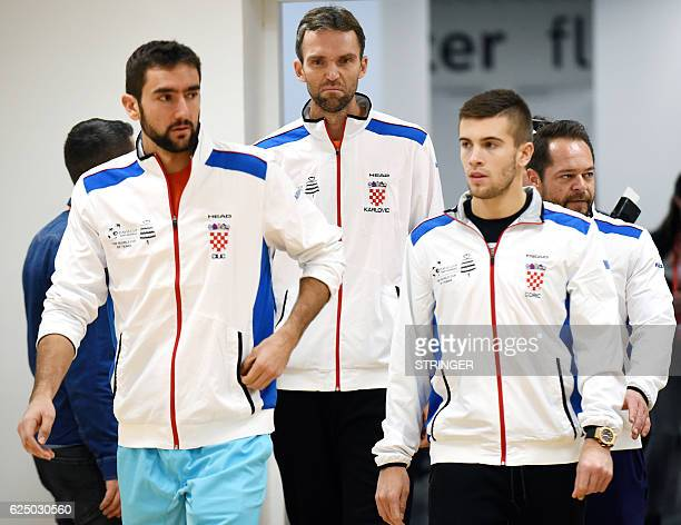 Croatia's Davis Cup team players Marin Cilic Borna Coric and Ivo Karlovic arrive to give a press conference on November 22 three days ahead of the...