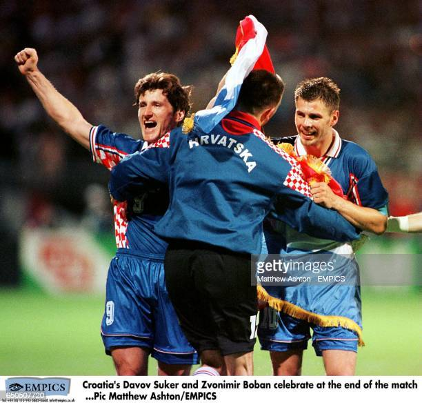 Croatia's Davor Suker and Zvonimir Boban celebrate at the end of the match