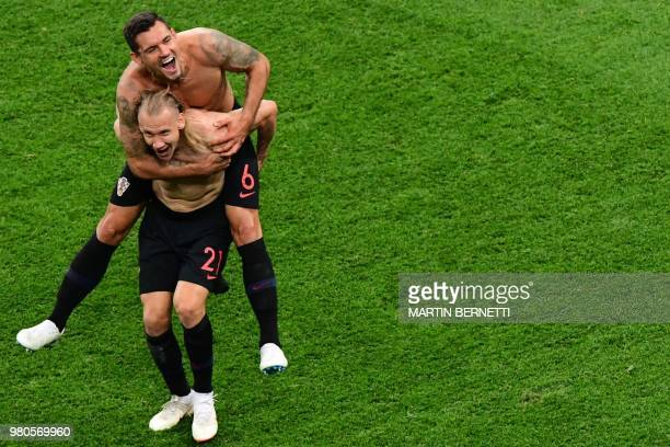 Croatia's defender Dejan Lovren and Croatia's defender Domagoj Vida celebrate at the end of the Russia 2018 World Cup Group D football match between...