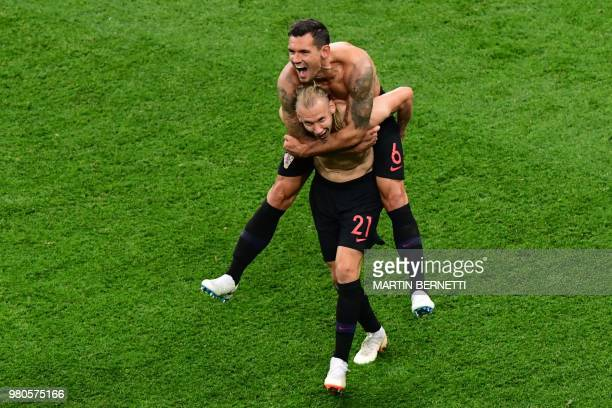 TOPSHOT Croatia's defender Dejan Lovren and Croatia's defender Domagoj Vida celebrate at the end of the Russia 2018 World Cup Group D football match...