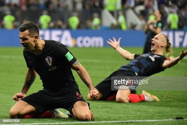 Croatia's defender Dejan Lovren and Croatia's defender Domagoj Vida celebrate at the end of the Russia 2018 World Cup semifinal football match...