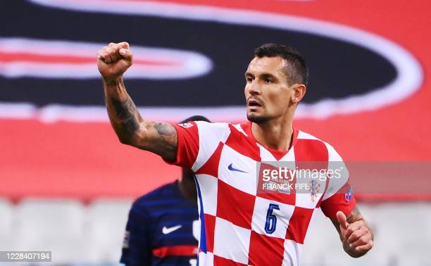 Croatia's defender Dejan Lovren celebrates after scoring a goal during the UEFA Nations League Group C football match between France and Croatia at...