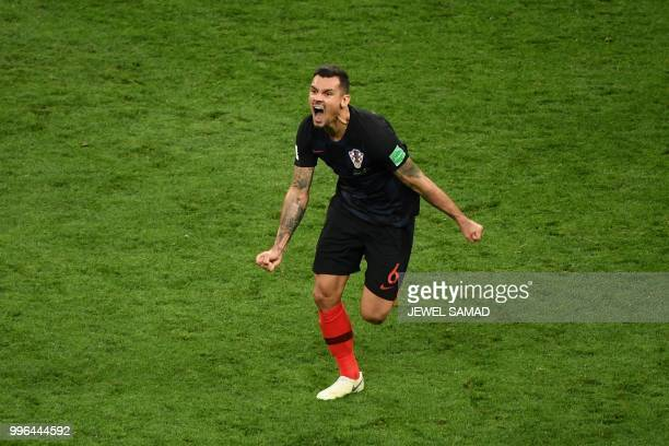 Croatia's defender Dejan Lovren celebrates after winning the Russia 2018 World Cup semi-final football match between Croatia and England at the...