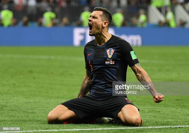 Croatia's defender Dejan Lovren celebrates at the end of the Russia 2018 World Cup semi-final football match between Croatia and England at the...