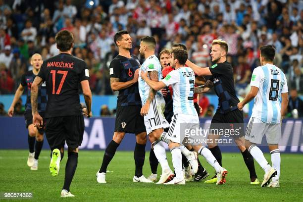 TOPSHOT Croatia's defender Dejan Lovren clashes with Argentina's defender Nicolas Otamendi during the Russia 2018 World Cup Group D football match...