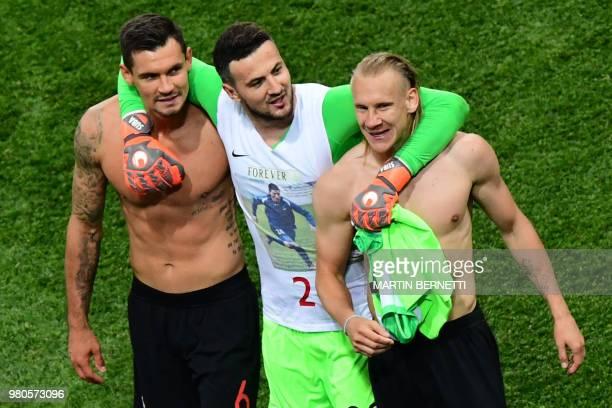 Croatia's defender Dejan Lovren Croatia's goalkeeper Danijel Subasic and Croatia's defender Domagoj Vida celebrate at the end of the Russia 2018...