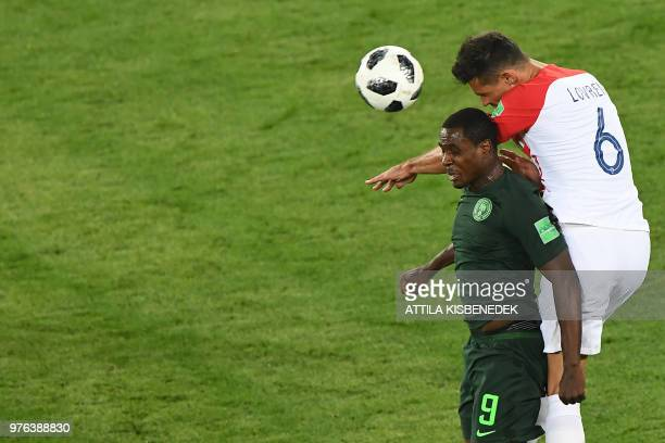 Croatia's defender Dejan Lovren fights for the ball with Nigeria's forward Odion Jude Ighalo during the Russia 2018 World Cup Group D football match...