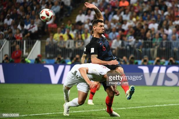 TOPSHOT Croatia's defender Dejan Lovren vies for the ball with England's forward Harry Kane during the Russia 2018 World Cup semifinal football match...