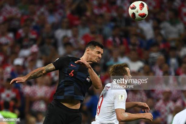 TOPSHOT Croatia's defender Dejan Lovren vies for the header with England's forward Harry Kane during the Russia 2018 World Cup semifinal football...