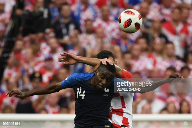 TOPSHOT Croatia's defender Dejan Lovren vies for the header with France's midfielder Blaise Matuidi during the Russia 2018 World Cup final football...