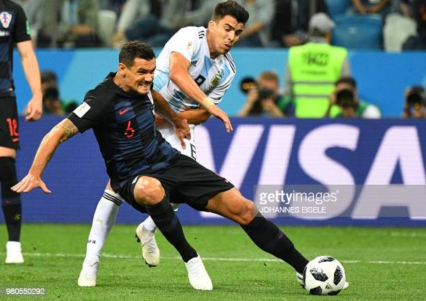 Croatia's defender Dejan Lovren vies with Argentina's defender Marcos Acuna during the Russia 2018 World Cup Group D football match between Argentina...