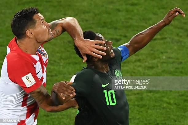 TOPSHOT Croatia's defender Dejan Lovren vies with Nigeria's midfielder John Obi Mikel during the Russia 2018 World Cup Group D football match between...