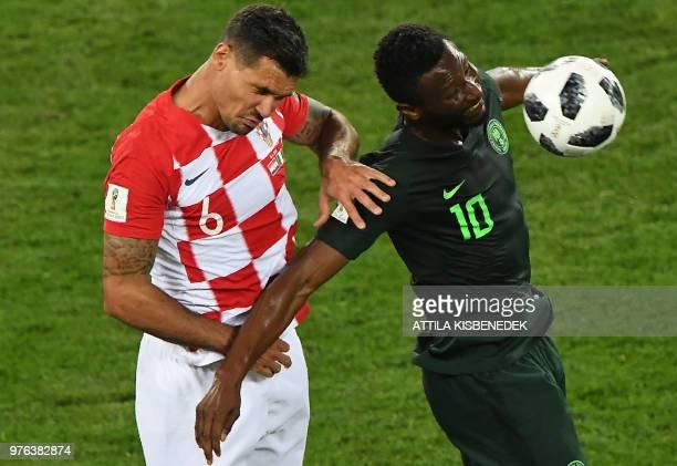 Croatia's defender Dejan Lovren vies with Nigeria's midfielder John Obi Mikel during the Russia 2018 World Cup Group D football match between Croatia...
