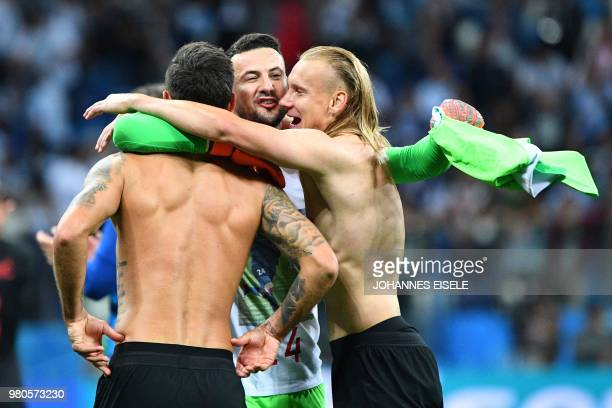 TOPSHOT Croatia's defender Domagoj Vida and teammates celebrate their victory at the end of the Russia 2018 World Cup Group D football match between...