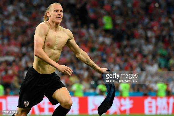 TOPSHOT Croatia's defender Domagoj Vida celebrates after scoring a goal during the extra time of the Russia 2018 World Cup quarterfinal football...