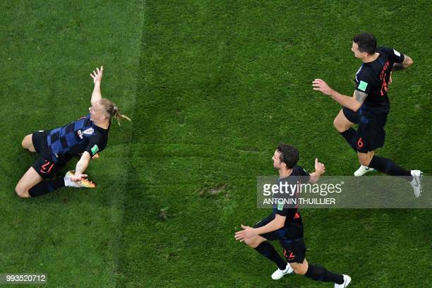 Croatia's defender Domagoj Vida celebrates at the end of the penalty shootouts of the Russia 2018 World Cup quarterfinal football match between...