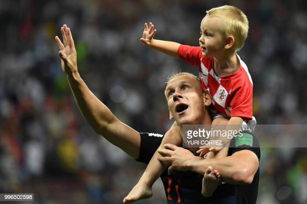 TOPSHOT Croatia's defender Domagoj Vida celebrates with his son David at the end of the Russia 2018 World Cup semifinal football match between...