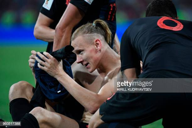 TOPSHOT Croatia's defender Domagoj Vida celebrates with teammates after scoring a goal during the extra time of the Russia 2018 World Cup...