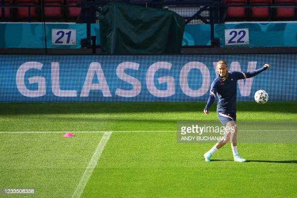 Croatia's defender Domagoj Vida controls a ball during their MD-1 training session at the Hampden Park in Glasgow on June 17, 2021 on the eve of...