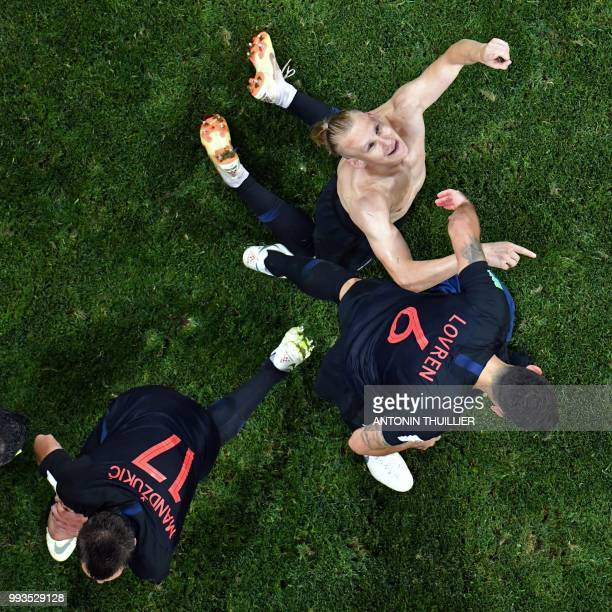 Croatia's defender Domagoj Vida is congratulated by teammates after scoring a goal during the Russia 2018 World Cup quarterfinal football match...