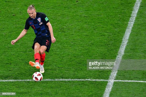Croatia's defender Domagoj Vida kicks the ball during the Russia 2018 World Cup semifinal football match between Croatia and England at the Luzhniki...