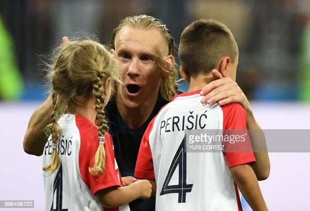 Croatia's defender Domagoj Vida speaks to the children of Croatia's forward Ivan Perisic Leonardo and Manuela at the end of the Russia 2018 World Cup...