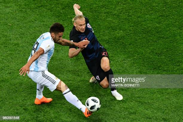 Croatia's defender Domagoj Vida vies with Argentina's midfielder Eduardo Salvio during the Russia 2018 World Cup Group D football match between...