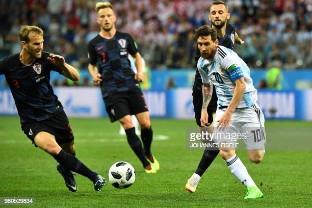 Croatia's defender Ivan Strinic vies with Argentina's forward Lionel Messi during the Russia 2018 World Cup Group D football match between Argentina...